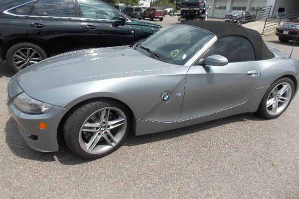 This 2007 BMW Z4 needed repairs done to its front bumper, end-panel, headlights, and wheels.