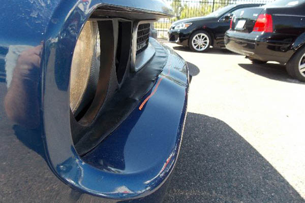 This 2010 Dodge Challenger needs its front bumper repaired