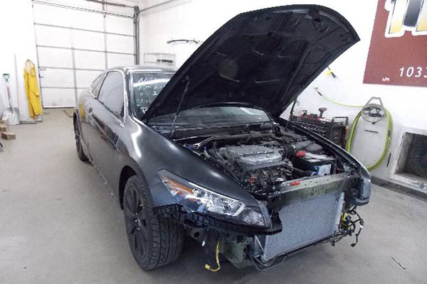 This 2009 Honda Accord was in an accident and suffered many damages to its front bumper and end-panel, radiator, air conditioning, front and rear doors, windshield and interior sheet-metal.